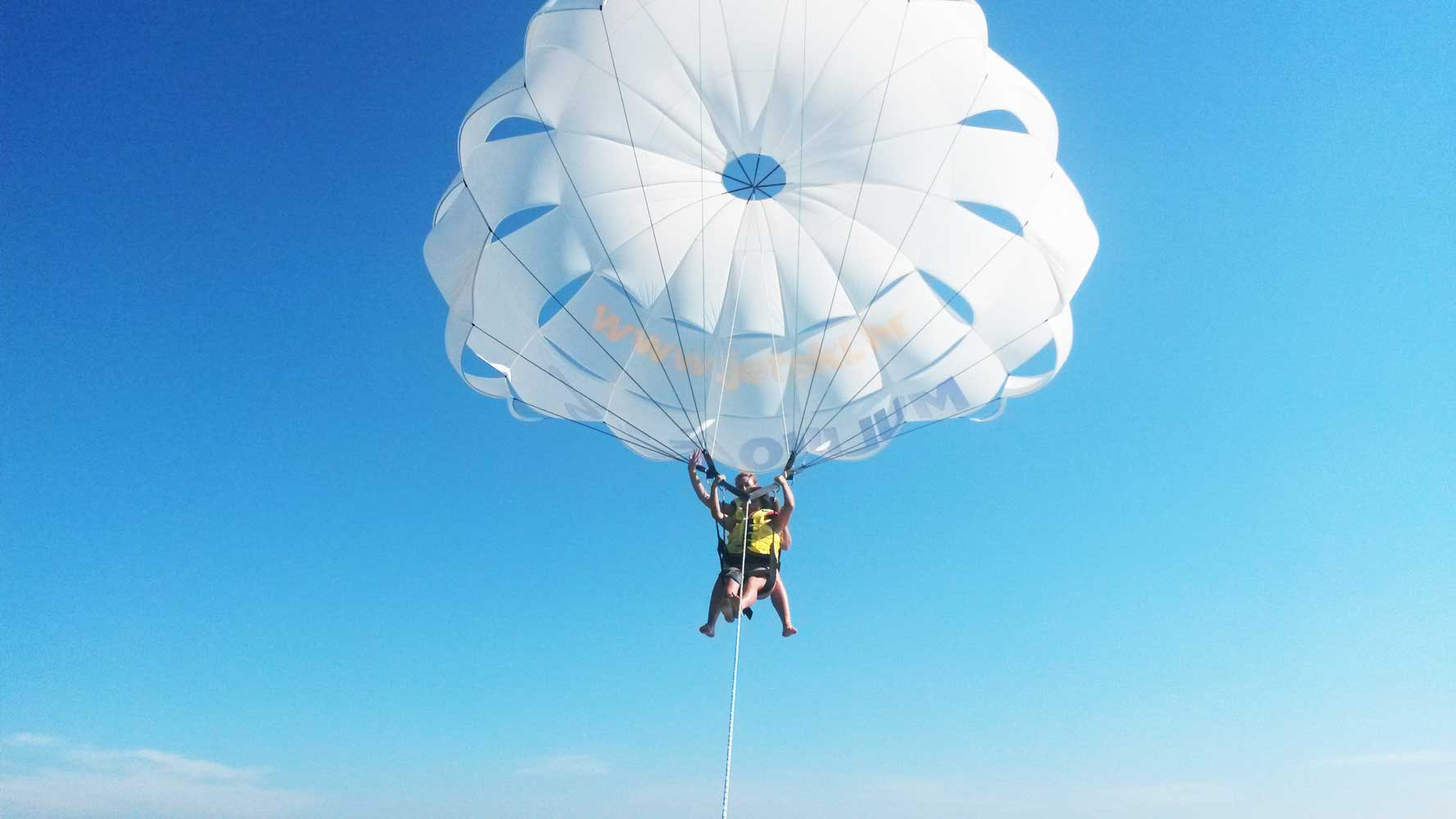 Parasailing - Water sports - Parachute rides on water